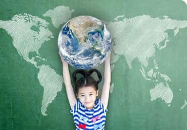 A little girl holding the planet Earth